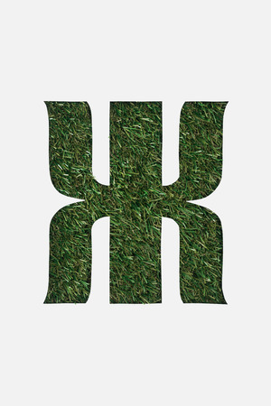 top view of cut out cyrillic letter with green grass on background isolated on white Banque d'images - 119798654