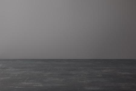 Empty textured shabby dark surface on grey background
