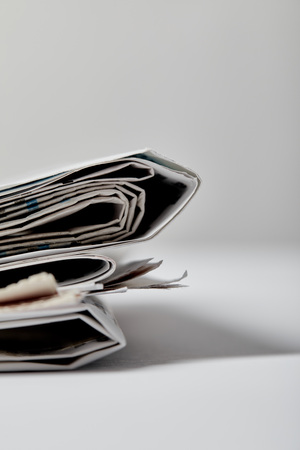 selective focus of newspapers with copy space on grey