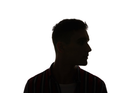 Silhouette of man in striped shirt looking away isolated on white