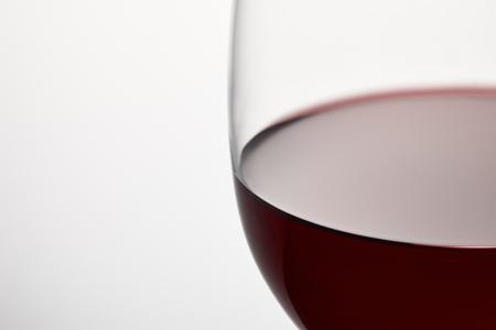 Wine glass of burgundy red wine on white Stok Fotoğraf