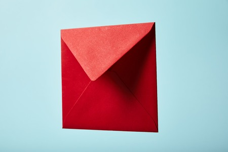 red and colorful envelope on blue background with copy space