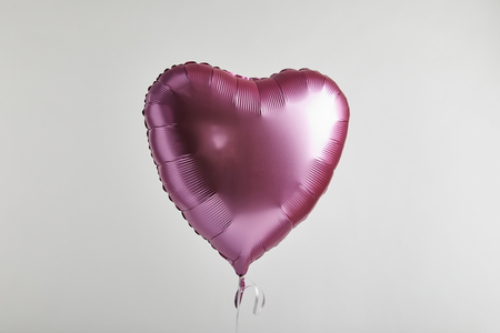 heart-shaped pink balloon isolated on white