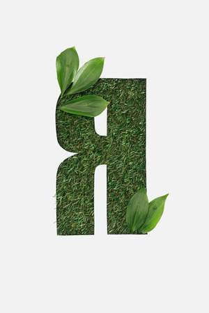 cut out cyrillic letter with green grass on background and leaves isolated on white