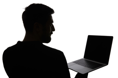Silhouette of man holding laptop with blank screen isolated on white Stock Photo
