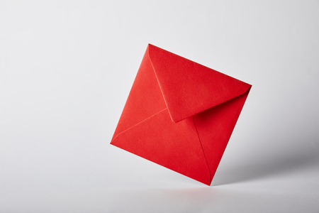 red and bright envelope on grey background with copy space