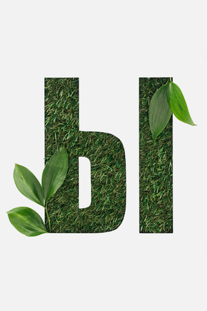 cut out cyrillic letter made of grass with green leaves isolated on white