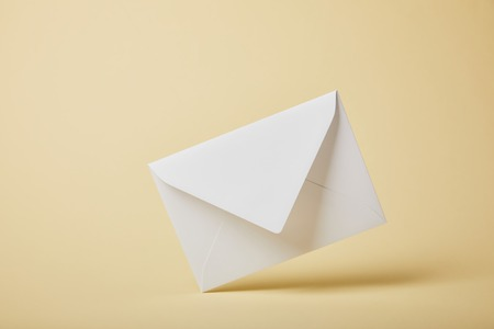 white and blank envelope on yellow background with copy space 스톡 콘텐츠