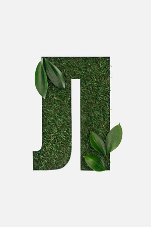 cut out cyrillic letter made of grass with green leaves in corners isolated on white