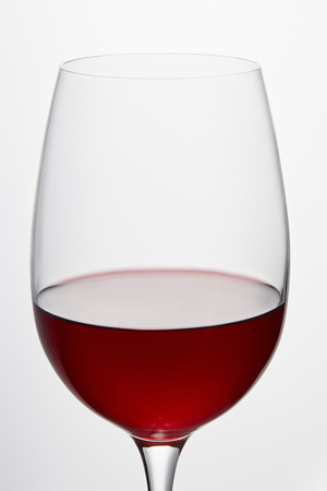 Wine glass with red wine isolated on white 写真素材