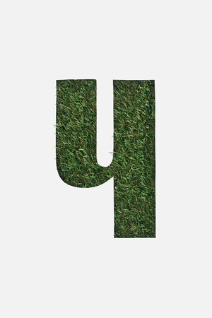 cut out cyrillic letter of green grass isolated on white