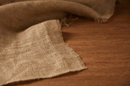 background with sackcloth on wooden surface with copy space Reklamní fotografie