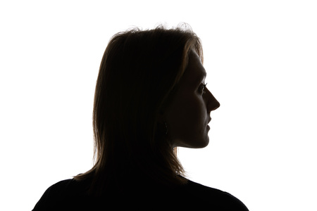 Silhouette of young woman looking away isolated on white Stockfoto