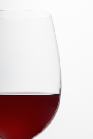 Glass of burgundy red wine isolated on white