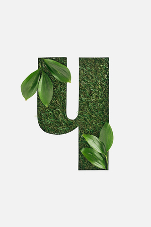 cut out cyrillic letter of green grass with leaves isolated on white