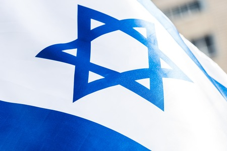 close up of blue star of david on national israel flag