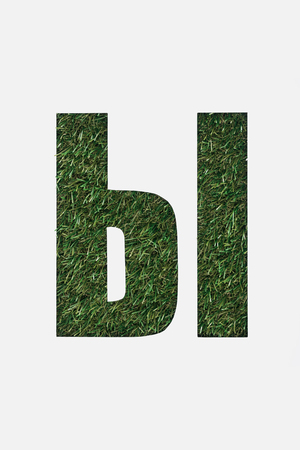 cut out letter from cyrillic alphabet made of fresh green grass isolated on white