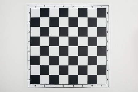 top view of empty  black and white chessboard on white background