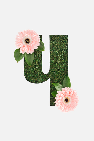 cut out cyrillic letter of green grass with pink gerberas isolated on white Stock Photo
