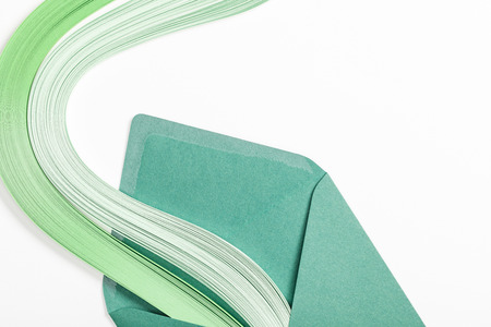 close up of green envelope with multicolored rainbow on white background 版權商用圖片