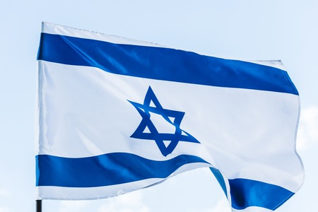 national flag of israel with star of david against sky