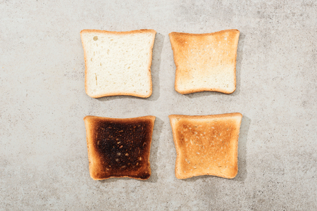 Top view of bread toasts on grey textured surface Stockfoto