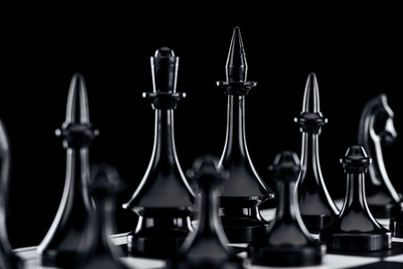 close up of chessboard with black chess figures isolated on black