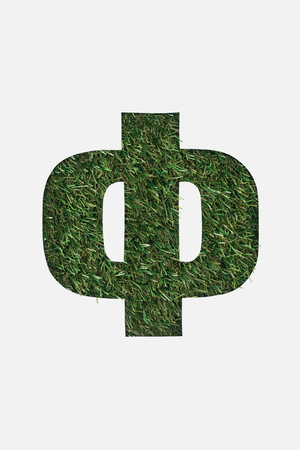 top view of cut out cyrillic letter with green grass on background isolated on white