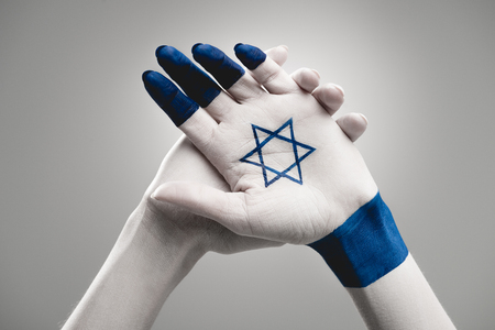 cropped view of female hands with star of david on grey