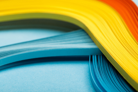 close up of yellow, orange and blue abstract bright lines on blue background