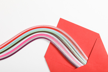 close up of red envelope with multicolored rainbow on white background 版權商用圖片