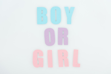 top view of pink, purple, blue boy or girl lettering isolated on white