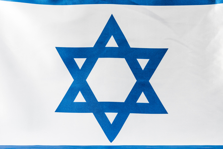 close up of blue star of david on national flag of israel