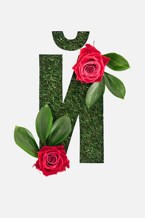 top view of cyrillic letter made of grass with fresh green leaves and red roses isolated on white Stock Photo