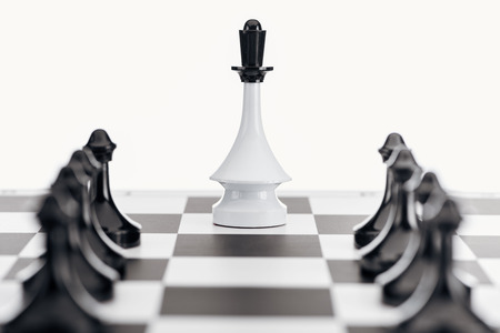 selective focus of chessboard with white queen figure and black pawns isolated on white