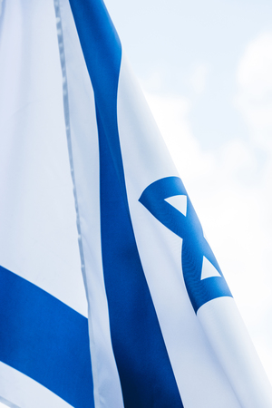 close up of national flag of israel against sky with clouds