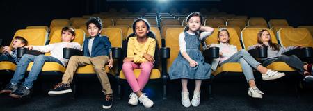 panoramic shot of multicultural friends spending time in cinema together Reklamní fotografie