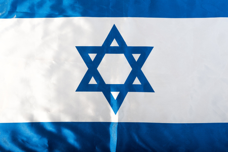 close up of national israel flag with blue star of david