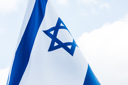 national israel flag with star of david against blue sky Stock Photo