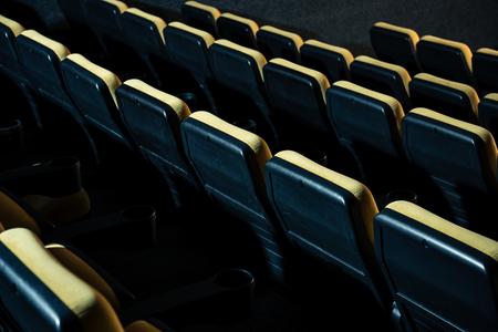 rows of comfortable plastic empty seats in cinema hall Banco de Imagens
