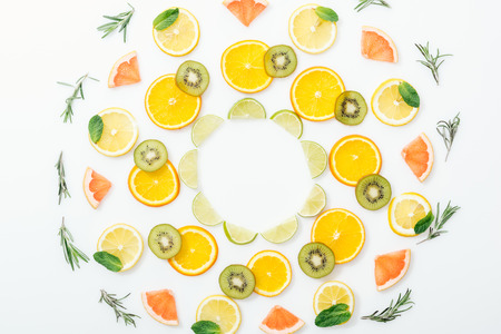 Flat lay with cut fruits and rosemary on white surface Banco de Imagens
