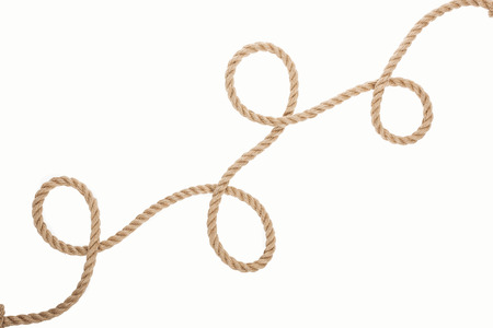 long, brown and jute rope with curls isolated on white