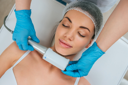 Cropped view of cosmetologist doing endospheres therapy for neck