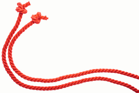 red long curled ropes with knots isolated on white