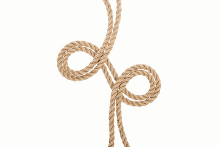 curled brown and jute ropes isolated on white 版權商用圖片