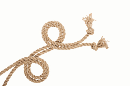 curled brown and jute ropes with knots isolated on white