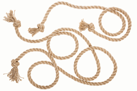 brown jute ropes with curls and knots isolated on white