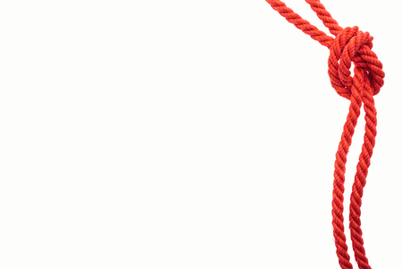 red jute ropes with sea knot isolated on white