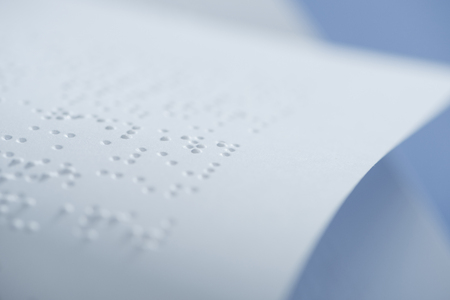 selective focus of braille text on white paper with copy space
