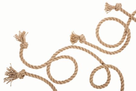 brown jute and curled ropes with knots isolated on white